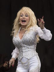 Dolly Parton performs on the main Pyramid stage at Glastonbury music festival, England, Sunday, June 29, 2014.