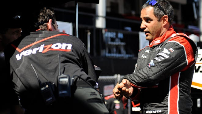 Juan Pablo Montoya, shown talking to his IndyCar crew at Long Beach, Calif., will make two Sprint Cup starts for Team Penske.