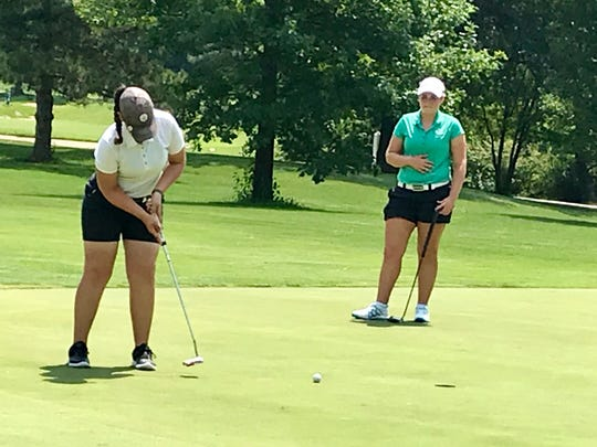 Mount Gilead's Mallory Graham putts the ball during