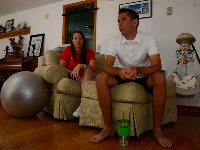 Greg Harris talks about how he met his wife Katy at Ithaca College while sitting in the living room in their Candor home.