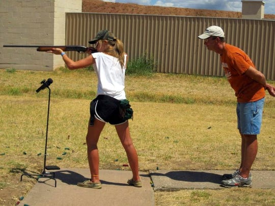 Alison Fields practices shooting under the watchful eye of her late father, Jathan Fields.