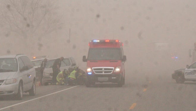 Mason Valley Fire District crews tend to an injured victim in a 10-vehicle crash Thursday east of Yerington.