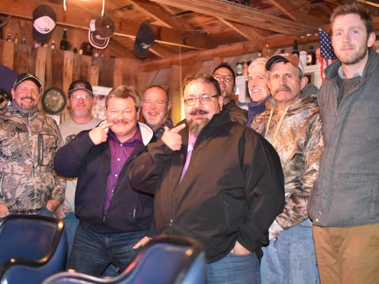 Chris Askins, Brian Thompson, Gerry Boschert, Allan Ross, Sean Moyle, Chris Jeka, Henry Crume, Hazen Adams and Cory Munson take a moment to pose before shaving their beards as part of the Movember event last Friday evening in Yerington.