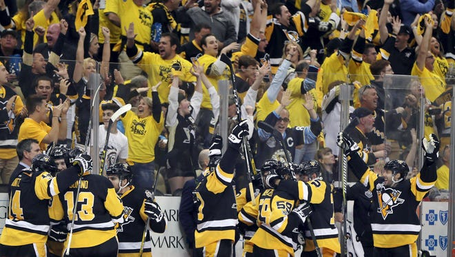 Pittsburgh Penguins and fans celebrate a goal by Penguins' Scott Wilson during the third period in Game 2 of the NHL hockey Stanley Cup Final against the Nashville Predators, Wednesday, May 31, 2017, in Pittsburgh. The Penguins won 4-1. (AP Photo/Keith Srakocic)