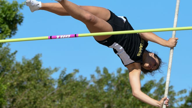 Abby Olson of Merritt Island competes in the pole vault during the Cape Coast Conference track meet in April.