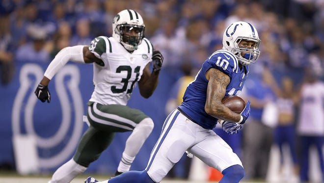 Indianapolis Colts wide receiver Donte Moncrief (10) outruns New York Jets cornerback Antonio Cromartie (31) after making a catch in the first half of their game against the New York Jets on Monday, Sept. 21, 2015, evening at Lucas Oil Stadium.