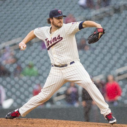 Sep 24, 2014; Minneapolis, MN, USA; Minnesota Twins starting pitcher Phil Hughes (45) pitches in the eighth inning against the Arizona Diamondbacks at Target Field. Mandatory Credit: Brad Rempel-USA TODAY Sports
