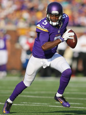 Vikings quarterback Teddy Bridgewater looks for an open receiver against the Falcons.
