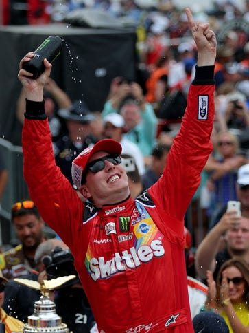 Kyle Busch celebrates his first victory in the Brickyard