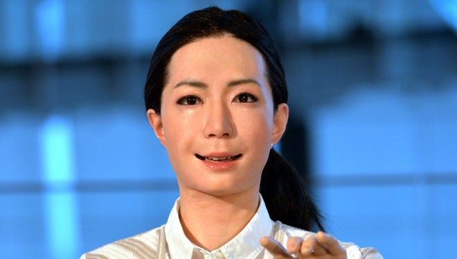 """The new humanoid robot named """"Otonaroid"""" gestures during a press preview at the National Museum of Emerging Science and Technology in Tokyo June 24.  Japanese scientists unveiled what they said was the world's first news-reading android, eerily lifelike and possessing a sense of humor to match her perfect language skills."""