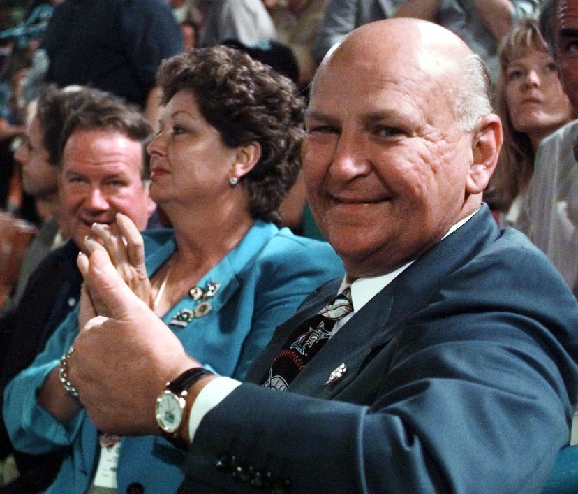In happier times, former Marlins owner H. Wayne Huizenga enjoys a game from the 1997 World Series, which his team won  in seven games.
