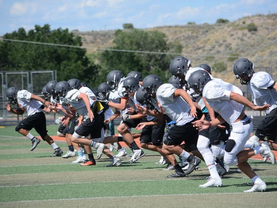 The Tigers, seen here practicing on Thursday, August 10, open the 2017 season 7 p.m. Friday at Los Lunas.