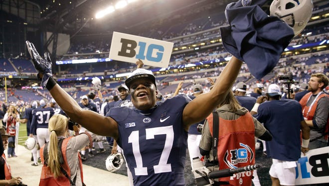 Penn State's Garrett Taylor celebrates his team's victory over Wisconsin in the Big Ten championship NCAA college football game Saturday, Dec. 3, 2016, in Indianapolis. Penn State won 38-31.