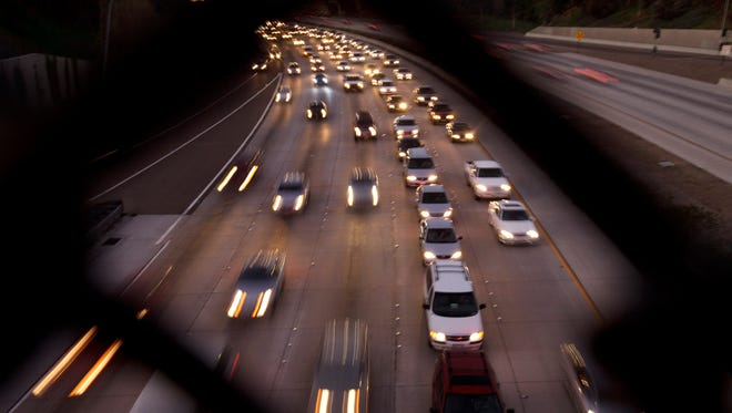 Cars fill the highway, Tuesday, Nov. 22, 2011, in San Diego. About 42.5 million people are expected to travel over Thanksgiving, the highest number since the start of the recession, according to a recent study. (AP Photo/Gregory Bull)