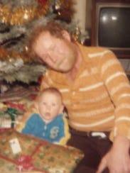 Chris Tanck, 6 months, and his father, Joe Tanck, at