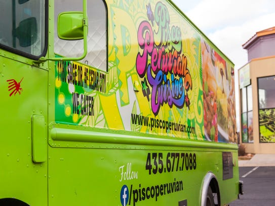 The Pisco Peruvian Cuisine food truck sits outside