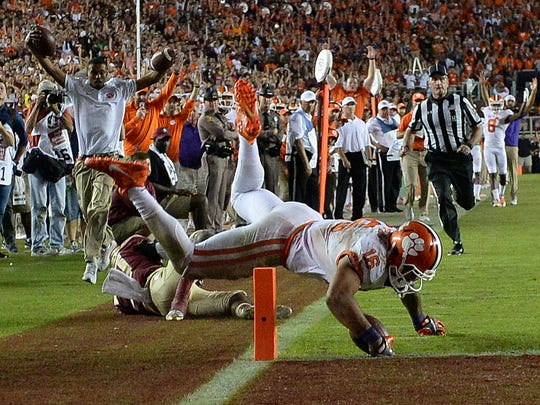Clemson tight end Jordan Leggett (16) scores against Florida State during the fourth quarter at Doak Campbell Stadium in Tallahassee, Florida on Saturday.