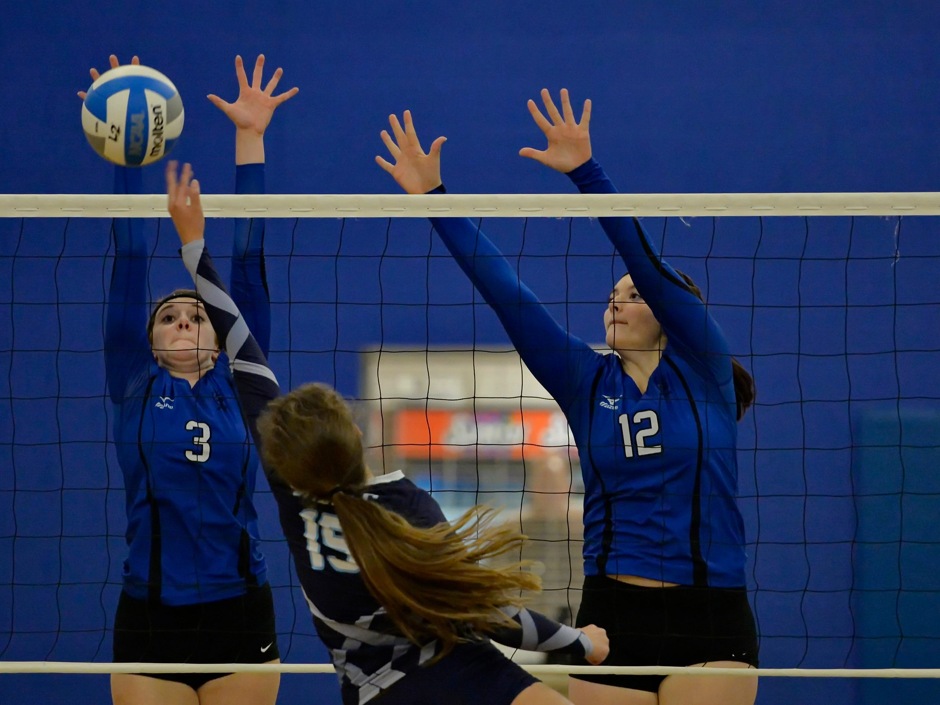 St. Joe's Kaely Thompson (3) and Michelle Malsch block a shot by Southside Christian's Emma Witt Tuesday