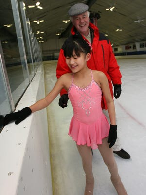 Lianna Thomas, of Congers, practices her ice skating routine with instructor Peter Burrows at Sport-O-Rama in Monsey Dec. 5, 2006.