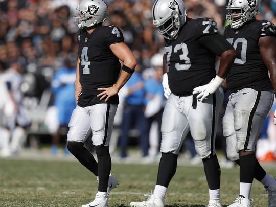 Oakland Raiders starting quarterback Derek Carr (4) walks off the field after throwing an interception against the Los Angeles Chargers in the third quarter on Sunday, Oct. 15, 2017 at the Coliseum in Oakland, Calif. (Nhat V. Meyer/Bay Area News Group/TNS)