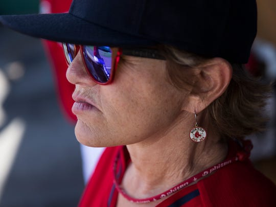 Carmen Pelletz, a resident of Tampa, Fla., embraces her Red Sox pride with team earrings as she prepares to play during the first round of the tournament during the second annual Women's Fantasy Baseball Camp at JetBlue Park Thursday, Jan. 12, 2017 in Fort Myers, Fla.