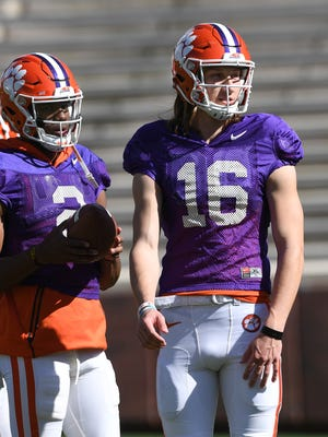 Clemson quarterbacks Kelly Bryant (2), left, and Trevor Lawrence (16) during the team's practice on Wednesday, April 4, 2018 at Clemson's Memorial Stadium.