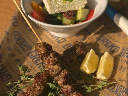 Pork souvlaki with a side of Horiatiki salad at GReKo