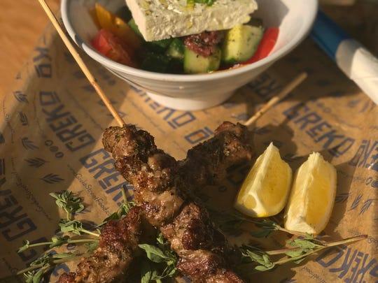 Pork souvlaki with a side of Horiatiki salad at GReKo Street Food.