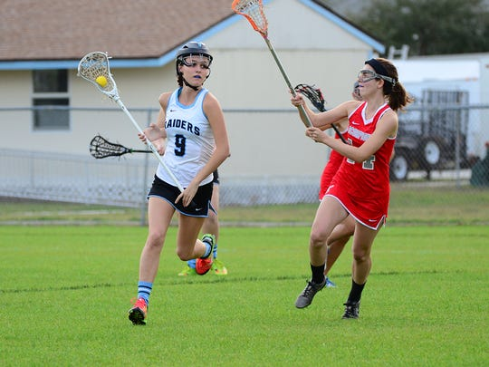 Kelly Hazlett of Satellite lacrosse (right)