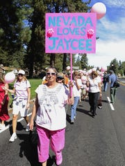 Laurel Manzola of Sparks walks in the Pink Ribbon Parade to honor Jaycee Lee Dugard in South Lake Tahoe on Sunday, Sept. 6, 2009.