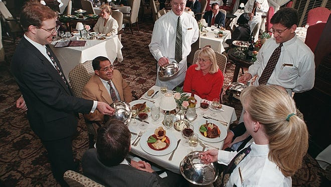 Adam Seger, director of restaurants; Troy Westrick; Merritt Bender; and Todd Augustine. Seated: Carl Seidler, gray suit; Dr. S.K. Das, brown jacket; Candy Stallings; and Tim Potter, obstructed. Dining in Oakroom at Seelbach Hotel. Photo by James H. Wallace 11/14/97