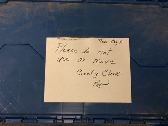 A sign on a moving box, one of many that on May 4, 2017 Macomb County Clerk/Register of Deeds Karen Spranger moved to a construction location inside the circuit court building from the clerk's office in Mt. Clemens. The box and others were returned later to the clerk's office.