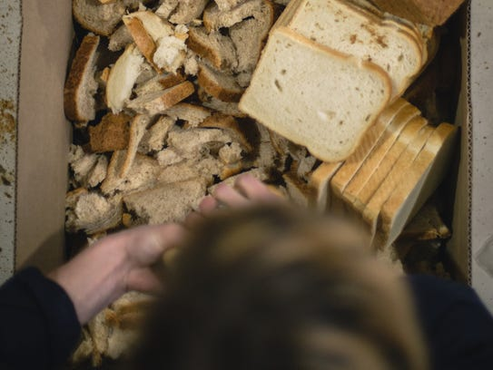 Bread is crushed in preparation for brewing the first