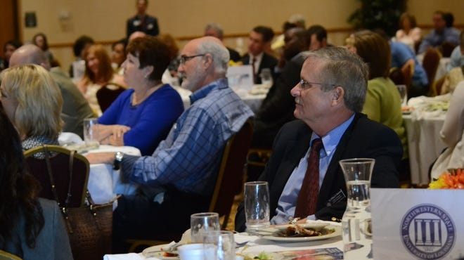 Attendants of the Central Louisiana Chamber of Commerce Luncheon listen as 5th Congressional District candidates answer questions during a political forum Monday. Candidates discussed job creation, increased oil and gas production and reduced government spending.