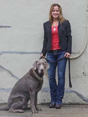 Jennifer Rutheny of Croton and Theo, her silver Labrador, photographed June 2, 2015. Theo's YouTube video, in which he figures out how to get across a bridge with a big stick in his mouth, has racked up over 16 million views.