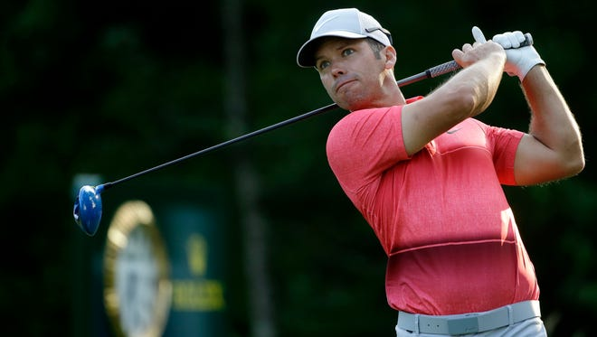 Paul Casey watches his tee shot on the 18th hole during the third round of the Deutsche Bank Championship golf tournament Sunday. The British golfer finished with a three-shot lead.