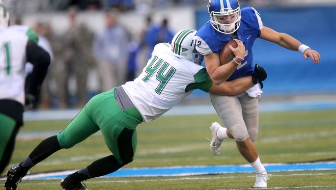 MTSU's quarterback Brent Stockstill (12) runs the ball as Marshall's Blake Keller (44) tackles Stockstill in the first half of an NCAA college football game against Marshall, on Saturday, Nov. 7, 2015, in Murfreesboro, Tenn.