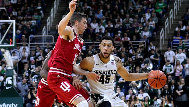 Spartans guard Denzel Valentine (45) brings the ball up the court while he's defended by Indiana forward Ryan Burton (10)  in the second half against Indiana Sunday, Feb. 14, 2016 in the Breslin Center in East Lansing.