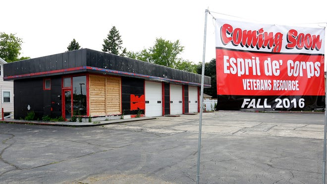 A sign announces a new veterans center, Espirit de' Corps,  that  will be opening at the corner of Scott and Main Streets in the city of Fond du Lac.