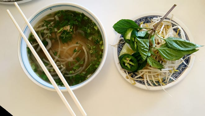 The Kien Giang Pho, a flavor filled Vietnamese noodle soup, comes with a plate of fresh condiments to add to the mix.