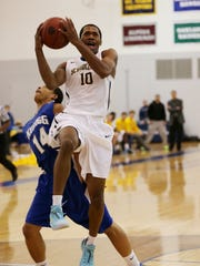 Soaring to the basket for a layup is Schoolcraft's