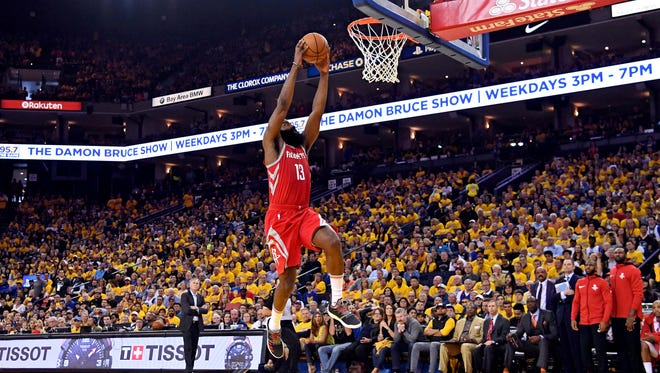 Houston Rockets guard James Harden (13) dunks the ball against the Golden State Warriors in game six of the Western conference finals of the 2018 NBA