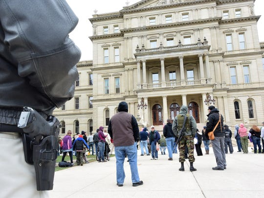 Second Amendment marchers milled around on the sidewalks and lawn of the capitol, and in a tent erected for the event.