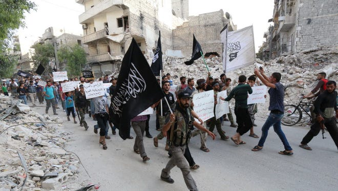 Supporters of Al-Qaeda affiliate al-Nusra Front in Aleppo, Syria, in 2014.