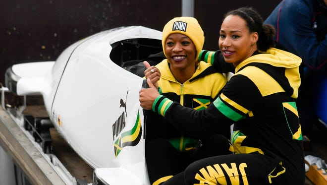Jamaica's Jazmine Victorian Fenlator (right) and Audra Segree react after the second run of the Women's race at the Bobsleigh World Cup in Altenberg, Germany.