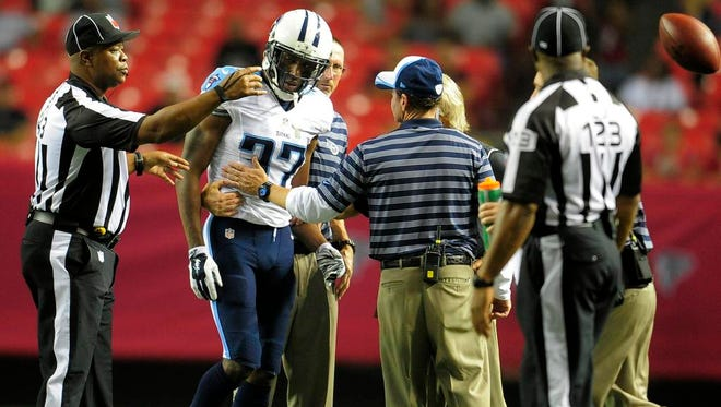 Titans cornerback Tommie Campbell is helped off the field during the fourth quarter.