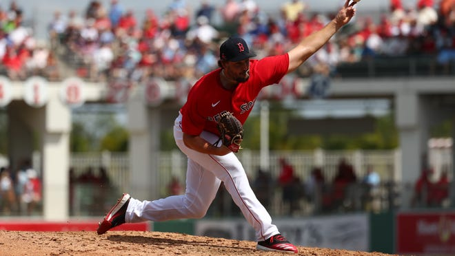 Boston Red Sox relief pitcher Josh Taylor (72) throws a pitch during the fourth inning against the St. Louis Cardinals at JetBlue Park .