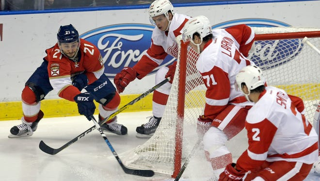 Panthers center Vincent Trocheck (21) comes around the goal to score against the Red Wings during the first period Saturday in Sunrise, Fla.