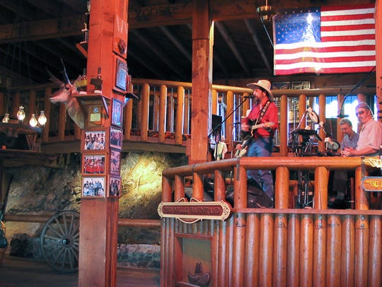 This Old West-style restaurant features a stainless-steel slide into the dining area, which offers a view of the Arizona sunset and twinkling city lights.