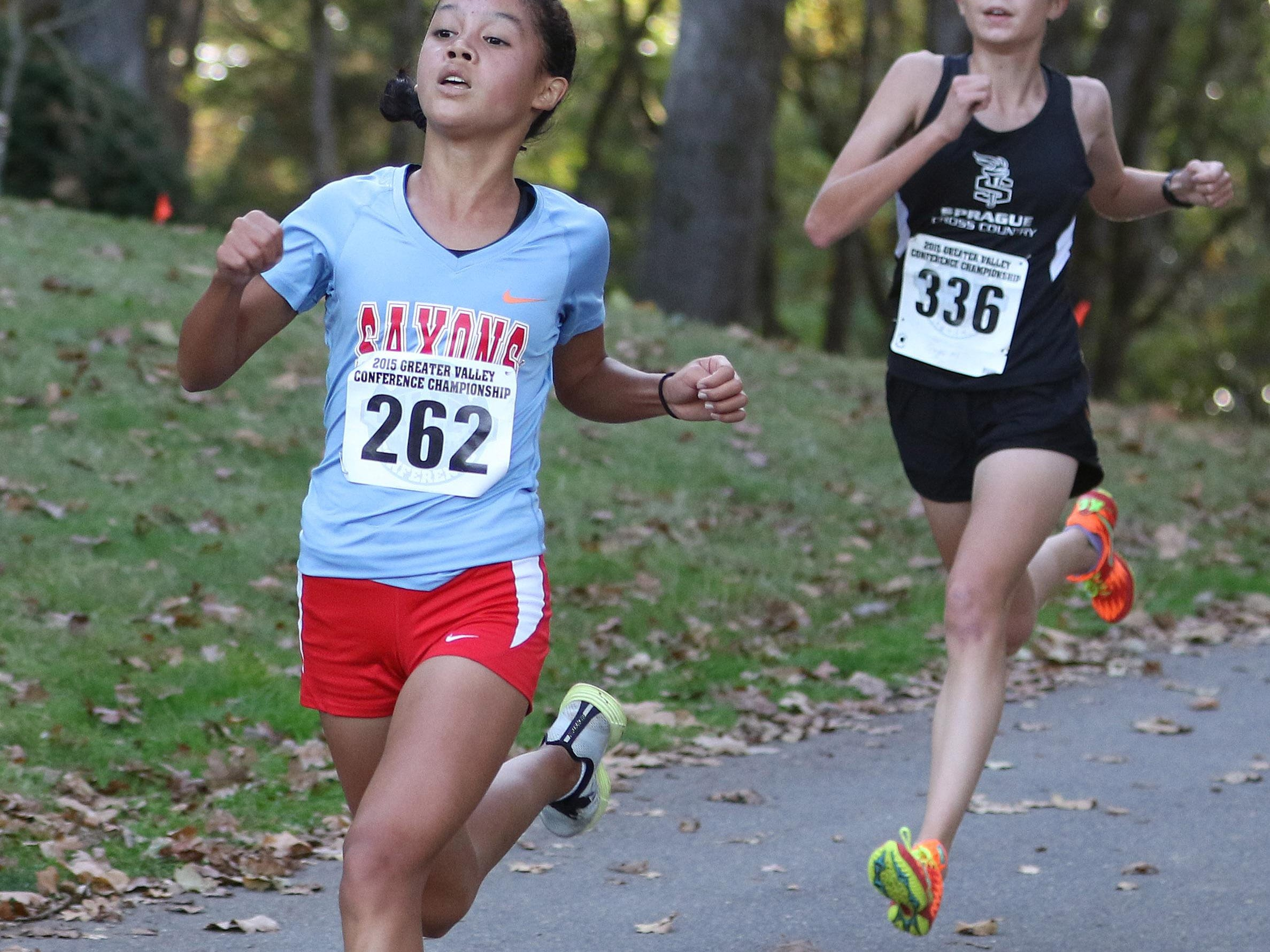 South Salem's Anna Chau and Sprague's Ginger Murnieks race in the Greater Valley Conference District Cross Country meet Wednesday, Oct. 21, 2015, at Bush's Pasture Park in Salem. Chau won the meet with a time of 17:52.